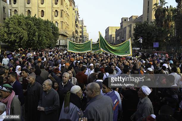 People attend a celebration held for the 1445th birth anniversary of Prophet Muhammad during the Mawlid alNabi in Cairo's AlJamaliya region Egypt on...