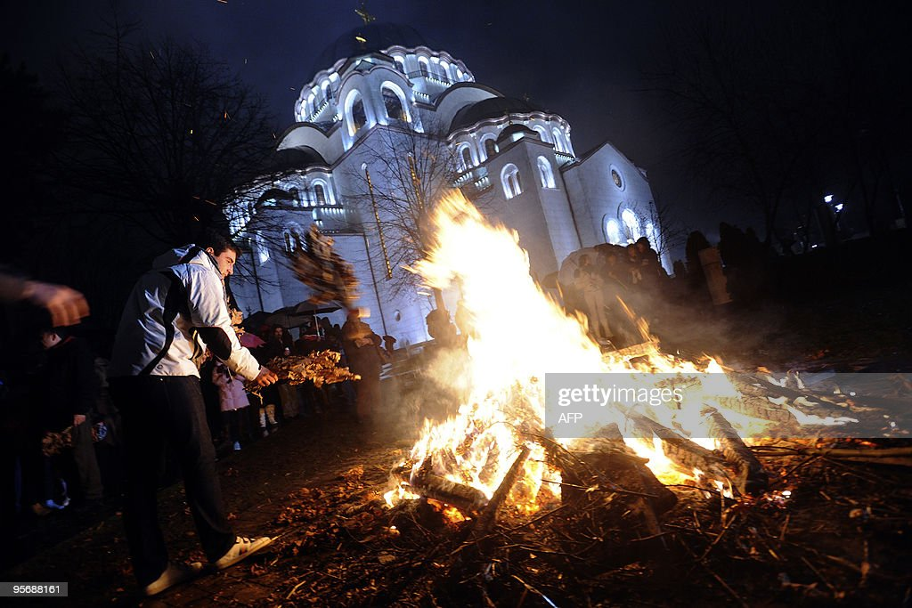 People attend a ceremonial burning of dried oak branches, the Yule log symbol for the Orthodox Christmas Eve in front of Saint Sava church in Belgrade on January 6, 2010. The Orthodox faith uses the old Julian calendar in which Christmas falls 13 days after its more widespread Gregorian calendar counterpart on December 25.