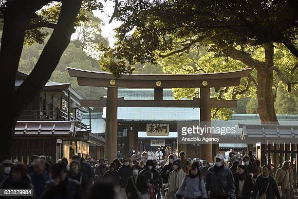 People attend a ceremony as newly promoted yokozuna Kisenosato who is the 72nd wrestler to reach the highest rank in professional sumo performs at...