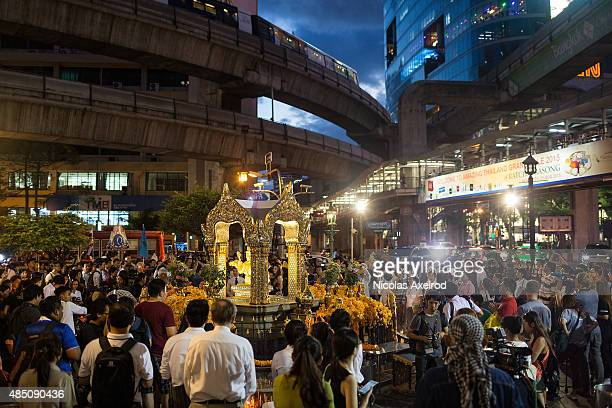 People attend a ceremony at the Erawan Shrine to commemorate the victims of the Bangkok bomb attack on August 24, 2015 in Bangkok, Thailand. A...