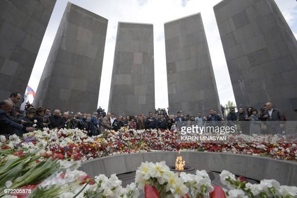 People attend a ceremony at the Genocide Memorial in Yerevan on April 24 to commemorate the 102nd anniversary of the World War Iera Armenian genocide...