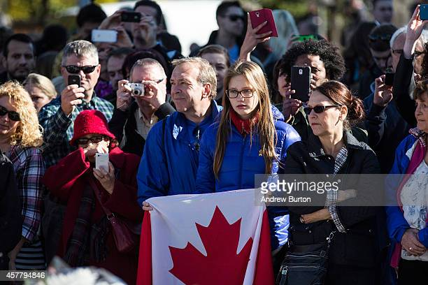 People attend a ceremony at the National War Memorial where Cpl Nathan Cirillo was killed two days ago on October 24 2014 in Ottawa Canada Two days...