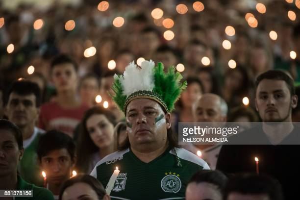 TOPSHOT People attend a ceremony in honour of the victims and survivors of Lamia flight 2933 on the first anniversary of the plane crash in Colombia...