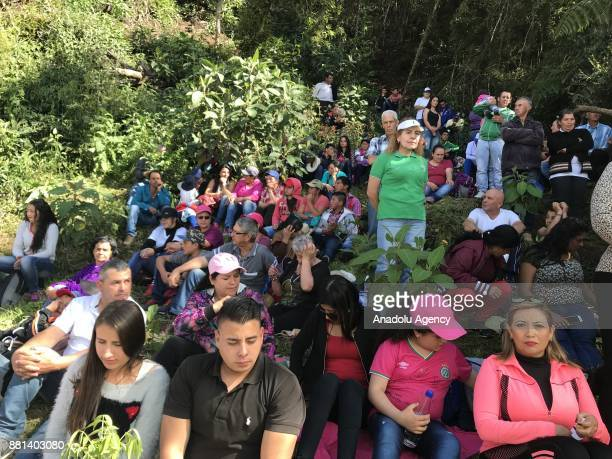 People attend a ceremony in honour of the victims and survivors of Lamia flight 2933 on the first anniversary of the plane crash in Colombia that...