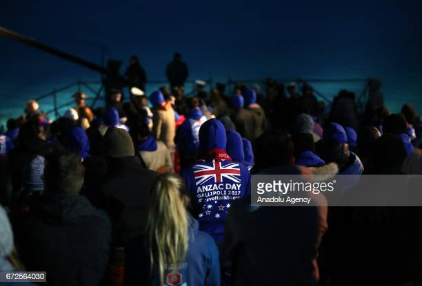 People attend a ceremony wrapping themselves with sleeping bag and thermal blankets during the ANZAC Dawn service in Canakkale Turkey on April 25...