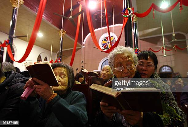 People attend a Christmas Eve mass at a church on December 24 2009 in Wezhou of Zhejiang Province China Christmas is not a public holiday in China...