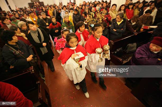 People attend a Christmas Eve mass at the St Joseph Church on December 24 2008 in Chongqing China Christmas is not a public holiday in China but it...