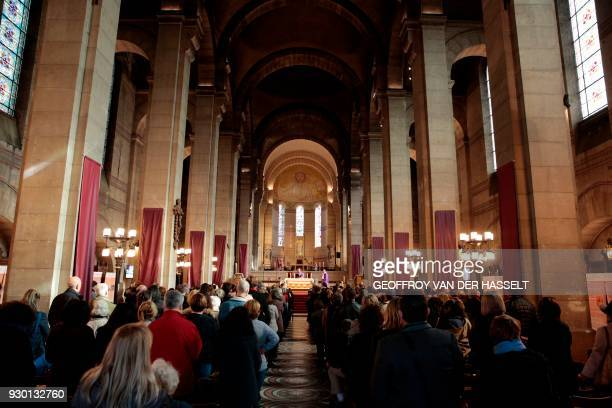 People attend a church service marking the 40th anniversary of French singer Claude Francois' death at the Notre Dame d'Auteuil church in Paris on...