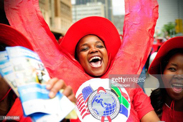 People attend a city march to mark the 23rd commemoration of World Aids Day on December 1 2011 in Johannesburg South Africa