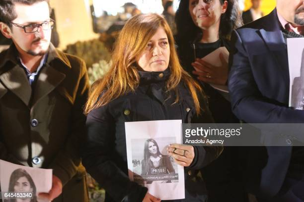 People attend a commemoration ceremony for Rudaw Tv reporter Shifa Gardi outside the Rudaw Tv building in Sulaymaniyah, Iraq on February 26,...