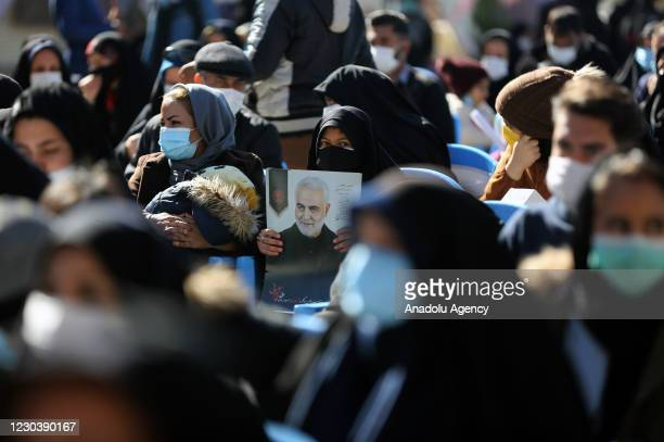 People attend a commemoration ceremony held within the first anniversary of Iranian Revolutionary Guards' Quds Force commander Qasem Soleimani's...