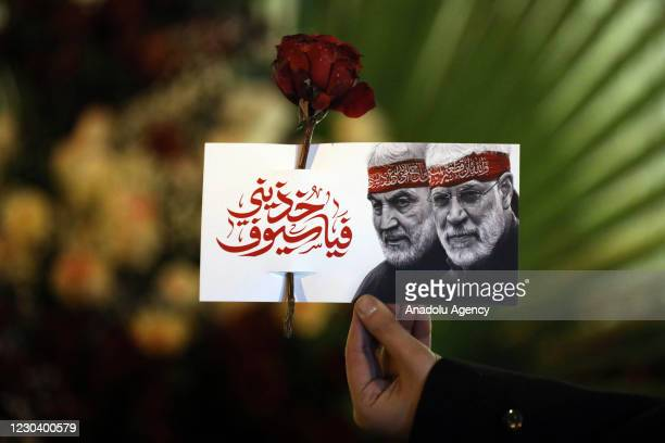 People attend a commemoration ceremony held within the first anniversary of the killing of Iranian Revolutionary Guards' Quds Force commander Qasem...