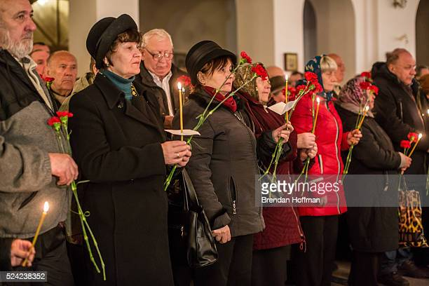 People attend a commemoration of the 30th anniversary of the Chernobyl nuclear accident at St Michael the Archangel Orthodox Church on April 26 2016...