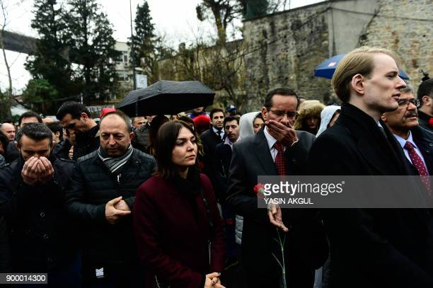 People attend a commemoration outside the Reina nightclub in Istanbul on December 31 a year after an attack on the club that left 39 dead Turkey on...