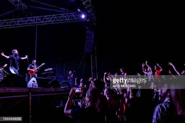 People attend a concert during an annual festival of the Greek Communist party youth wing in Athens on September 21 2018 The Greek Communist party...