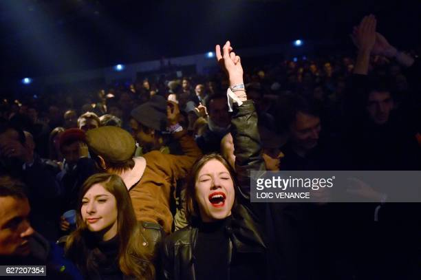 People attend a concert of British band HMLTD at the Transmusicales music festival on December 1 2016 in SaintJacquesdelaLande western France