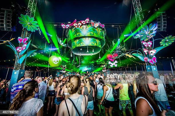People attend a concert on the last day of the 10th edition of the Belgian Tomorrowland electro music festival on July 27 in Boom AFP PHOTO / BELGA /...
