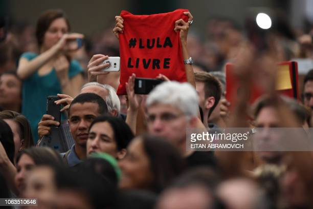 People attend a conference by former Brazilian president Dilma Rousseff in the framework of the First World Critical Thinking Forum in Buenos Aires...