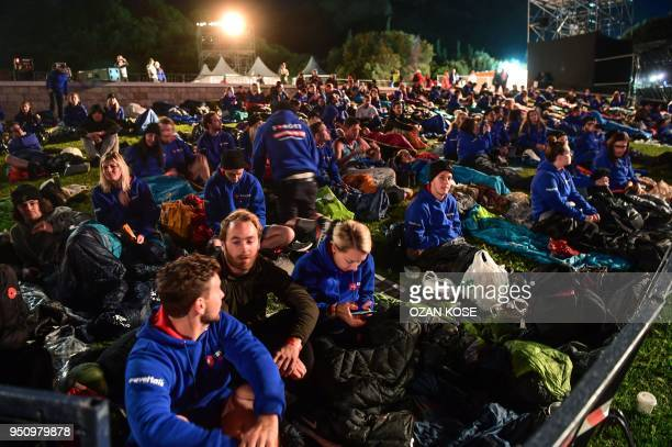 People attend a dawn service marking the 103rd anniversary of ANZAC Day in Canakkale Turkey on April 25 2018 The April 25 1915 landing of the...