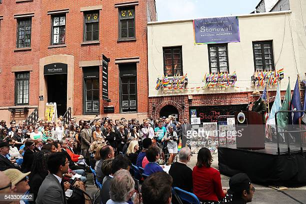 People attend a dedication ceremony officially designating the Stonewall Inn as a national monument to gay rights on June 27 2016 in New York City...