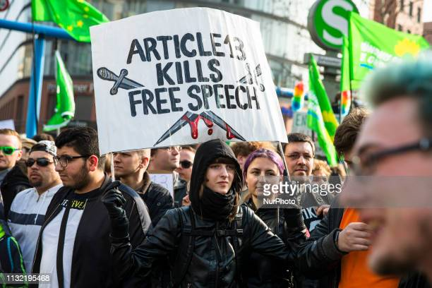People attend a demonstration against Article 13 of the planned EU reform of copyright and against censorship in internet in Berlin Germany on March...