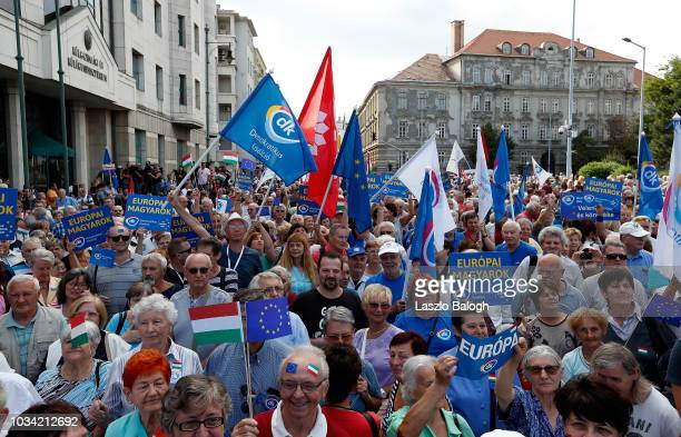 People attend a demonstration against Hungary's Prime Minister Viktor Orban on September 16 2018 in Budapest Hungary Hundreds turned out to protest...