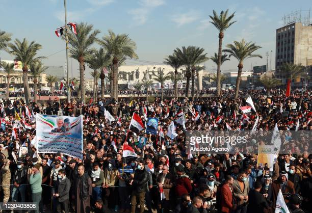 People attend a demonstration at Tahrir Square to commemorate the first anniversary of the killing of Iranian Revolutionary Guards' Quds Force...