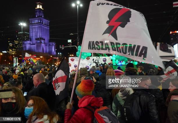 People attend a demonstration demanding the restoring of the right to abortion in Poland on October 22, 2021 in Warsaw, marking the first anniverary...