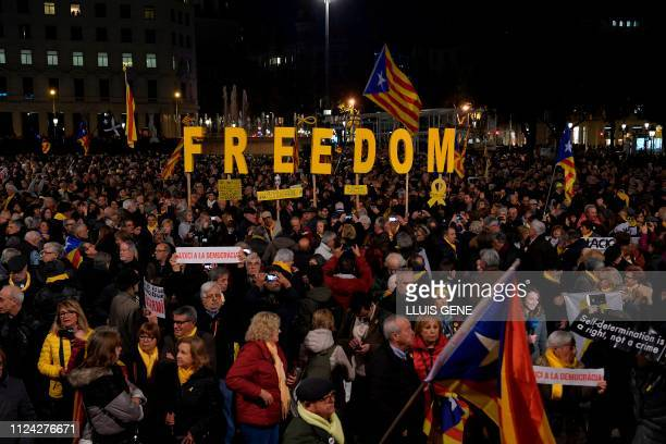 People attend a demonstration in Barcelona against the trial of former Catalan separatist leaders on February 12 2019 Twelve former Catalan leaders...