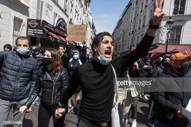 People attend a demonstration in support of Palestine, which was banned by authorities, on May 15 in Paris, France. Several Israeli cities have...