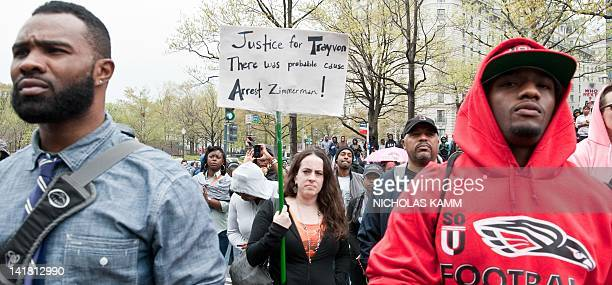 People attend a demonstration in Washington on March 24, 2012 to demand justice for Trayvon Martin, an unarmed black Florida teenager shot to death...