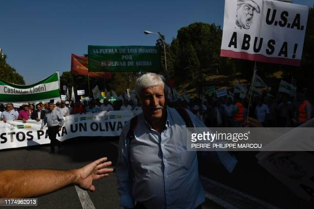 People attend a demonstration on October 10 2019 in Madrid called by the olive sector to denounce low prices of olive oil and the 25 percent tariff...