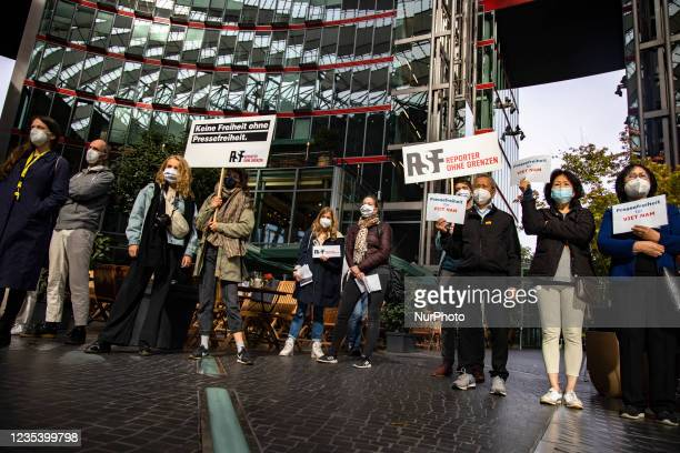 People attend a demonstration organized from Reporters without Borders against censorship of journalistic content on Facebook and other social...