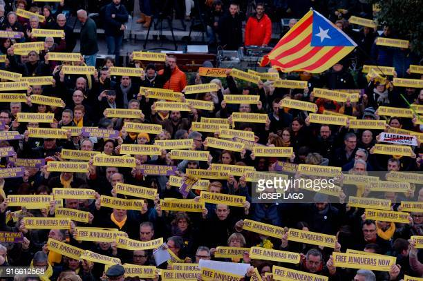 People attend a demonstration to protest against the 100 days of prison of Catalonia's jailed former vice president Oriol Junqueras at Sant Vicenc...
