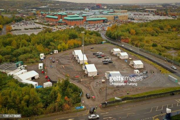 People attend a drive through Covid-19 testing site near Meadowhall Shopping Centre on October 22, 2020 in Sheffield, England. The county of South...