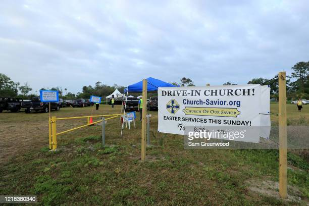 People attend a drivein Easter service at the Church of Our Savior service amid the coronavirus outbreak on April 12 2020 in Jacksonville Beach...