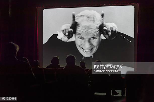 People attend a film projection during a press visit of Chaplin's World Museum in CorsiersurVevey western Switzerland on April 16 2016 Imagine moving...