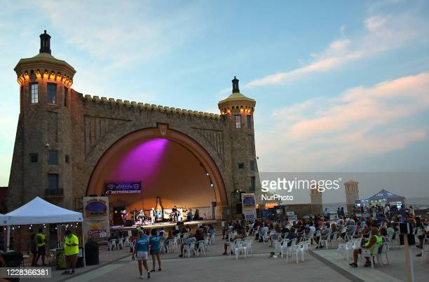 People attend a free concert at the Daytona Beach Bandshell on Labor Day weekend on September 5, 2020 in Daytona Beach, Florida. Face masks and...