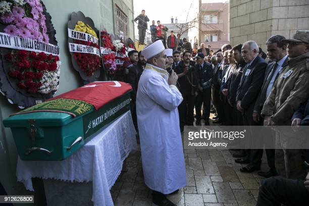 People attend a funeral ceremony held for Fatma Avlar who was killed after a rocket fired by PYD/PKK terrorists from Syria's Afrin hit Hatay's...