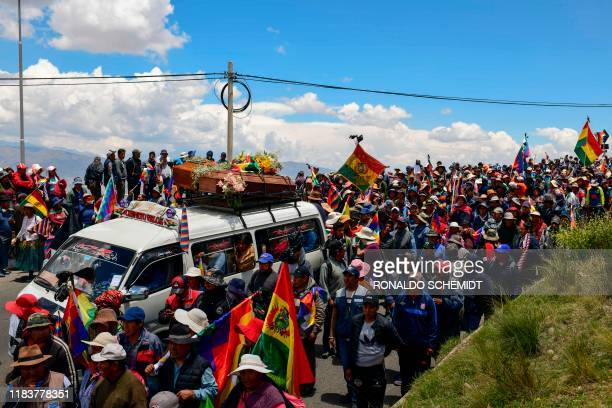 TOPSHOT People attend a funeral procession of eight supporters of Bolivia's exPresident Evo Morales killed when security forces lifted a siege on a...