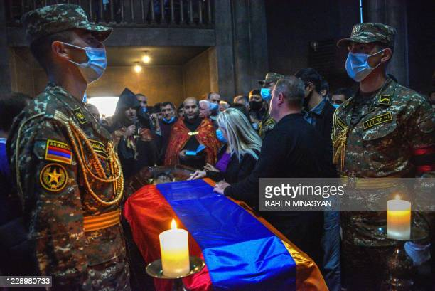 People attend a funeral service of an Armenian soldier who died in recent military clashes between Armenia and Azerbaijan over the disputed region of...