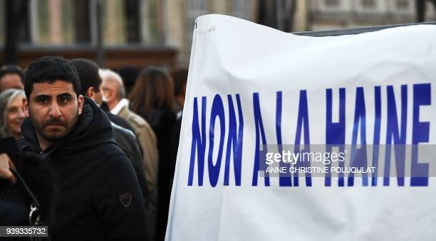People attend a gathering in Marseille on March 28 in memory of Mireille Knoll an 85yearold Jewish woman murdered in her home in Paris in what police...