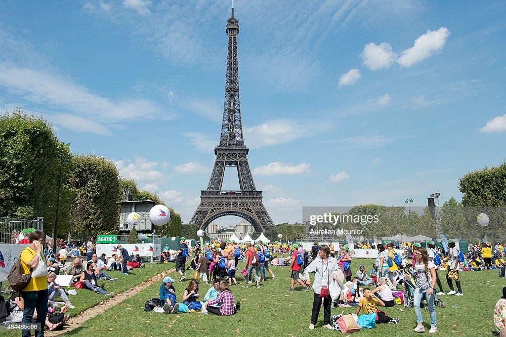 Secours Populaire Organises The 'Journee Mondiale Des Oublies Des Vacances' At Champs De Mars In Paris : News Photo