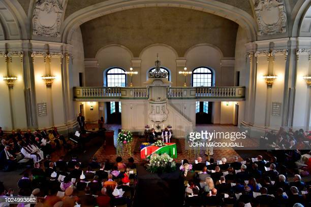 People attend a handing-over ceremony for human remains that were brought to Berlin during its colonial rule of the African nation on August 29, 2018...