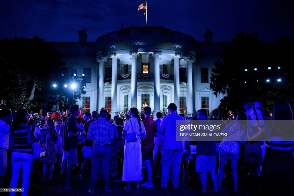 TOPSHOT - People attend a Independence Day celebration on the South Lawn of the White House July 4, 2018 in Washington, DC.