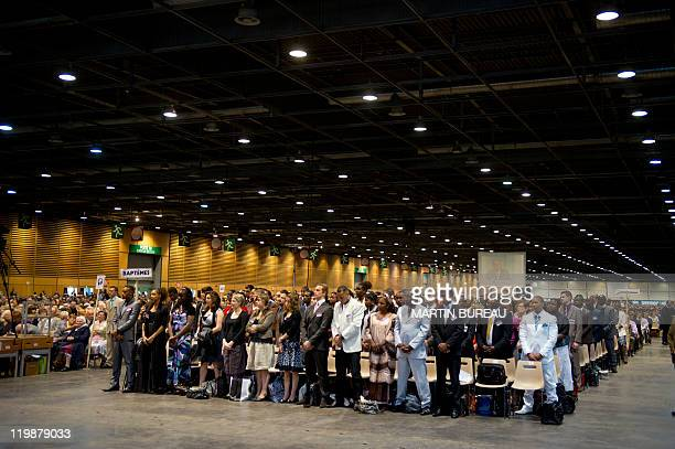 People attend a Jehovah's Witnesses assembly gathering 30000 believers on July 23 2011 in Villepinte Paris suburb European rights judges said on June...