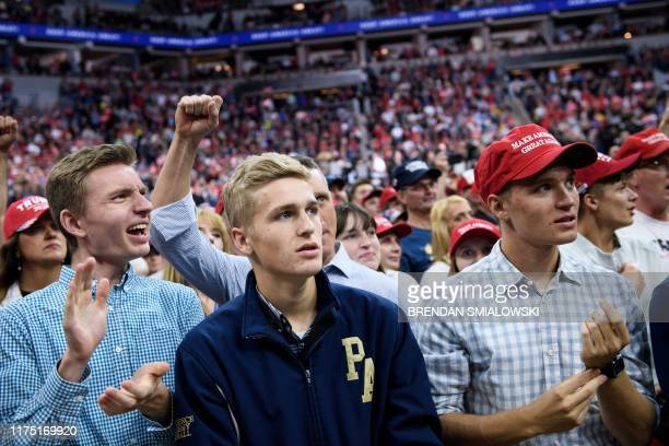 """People attend a """"Keep America Great"""" rally at the Target Center in Minneapolis, Minnesota on October 10, 2019."""
