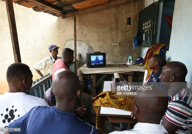 TOPSHOT People attend a live broadcast of the trial of former Ivorian president Laurent Gbagbo in front of the International Criminal Court in The...