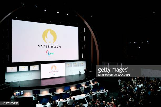 People attend a logo presentation ceremony for Paris 2024 Olympic Games at the Grand Rex cinema in Paris on October 21 2019