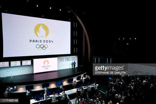 TOPSHOT People attend a logo presentation ceremony for Paris 2024 Olympic Games at the Grand Rex cinema in Paris on October 21 2019